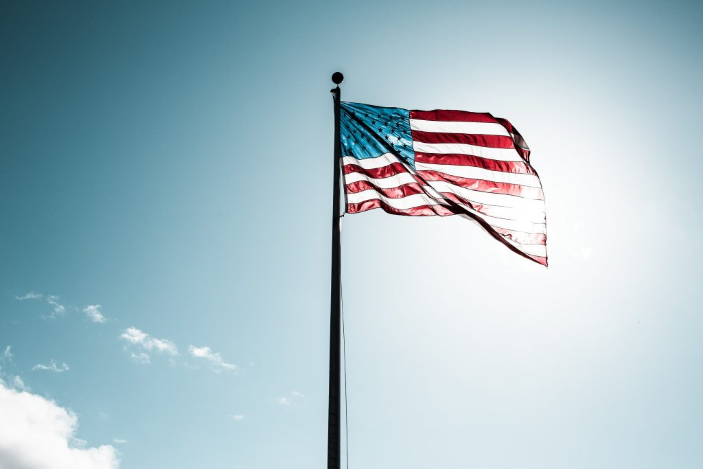 American flag waving in the sun